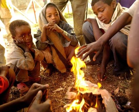 Street children keeping warm